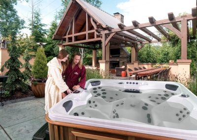 Young couple in robes ready to enjoy an Arctic Spa hot tub together