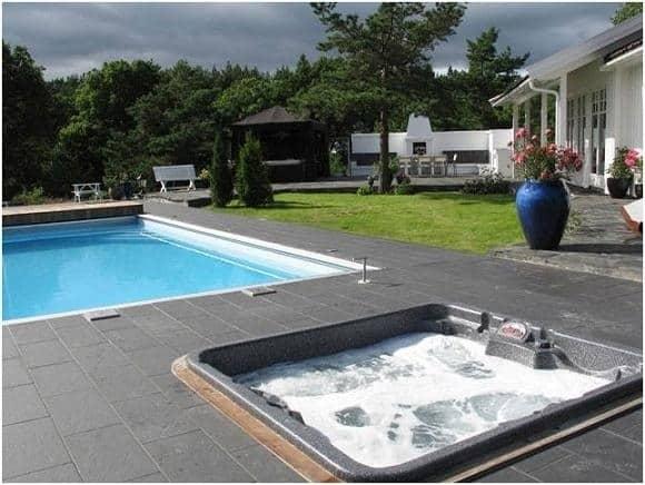 arctic spas hot tub in pool deck